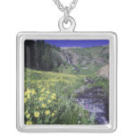 Waterfall and wildflowers in alpine meadow, 2 square pendant necklace