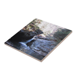 Waterfall between rocky outcroppings tile