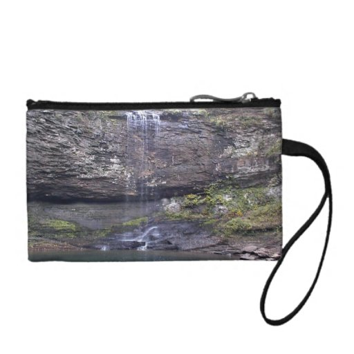 Waterfall flowing down the cliffs into a pool coin wallet