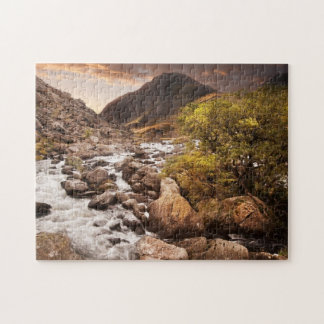 Waterfall In Mountains With Moody Dramatic Jigsaw Puzzle