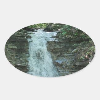 Waterfall in Woods Oval Sticker