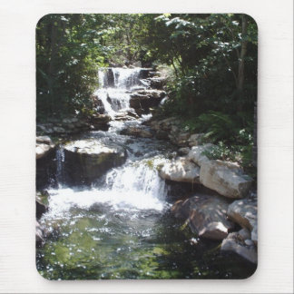 Waterfall streams over rocks into calm pool mouse pad