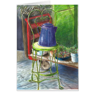 watering can on a chair -well used gardener's tool card