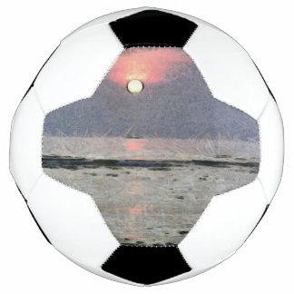 Watery sunset soccer ball