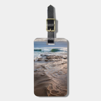 Wave breaking on beach, California Bag Tag