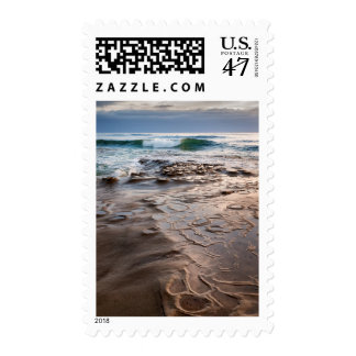 Wave breaking on beach, California Postage