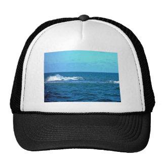 Wave breaking on reef hats