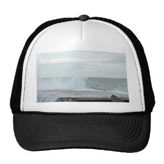 Wave Breaking On Rocks On The Beach Hats