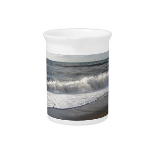 Wave of the sea on the sand beach beverage pitcher