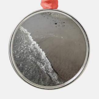 Wave of the sea on the sand beach metal ornament