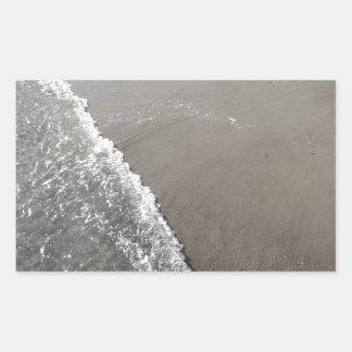 Wave of the sea on the sand beach rectangular sticker