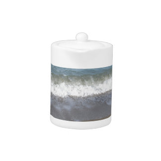 Wave of the sea on the sand beach teapot