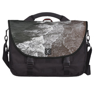 Waves breaking on a sandy beach commuter bag