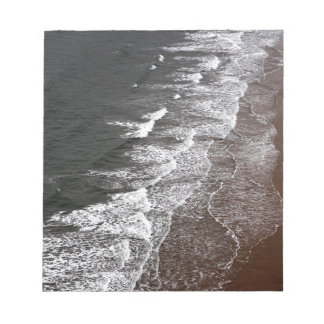 Waves breaking on a sandy beach notepad