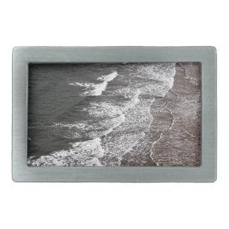 Waves breaking on a sandy beach rectangular belt buckle