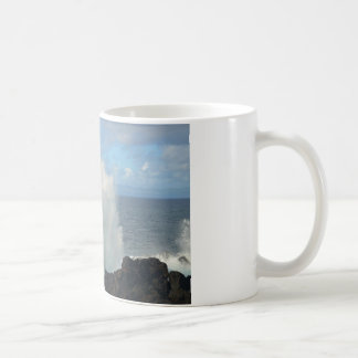 Waves breaking on a volcanic shore coffee mug