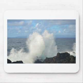 Waves breaking on a volcanic shore mouse pad