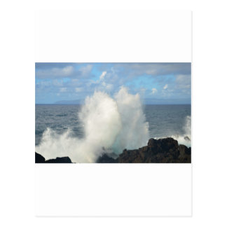 Waves breaking on a volcanic shore postcard
