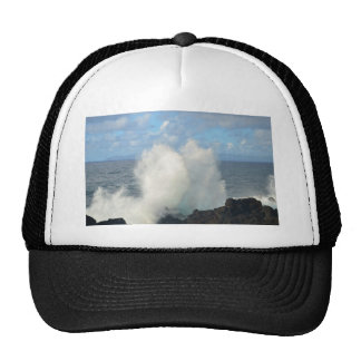 Waves breaking on a volcanic shore trucker hat