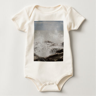 Waves breaking on rocks baby bodysuit