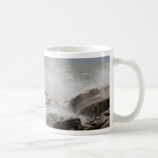 Waves breaking on rocks coffee mug