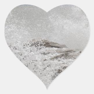 Waves breaking on rocks heart sticker