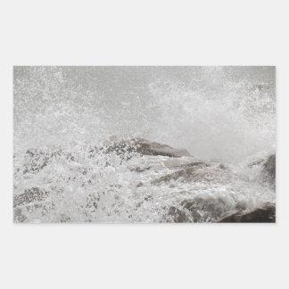 Waves breaking on rocks rectangular sticker