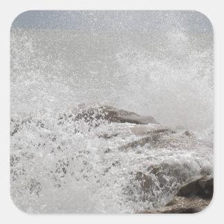 Waves breaking on rocks square sticker