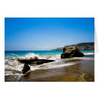Waves crash on beach greeting card
