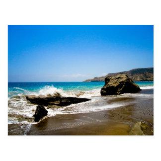 Waves crash on beach post cards
