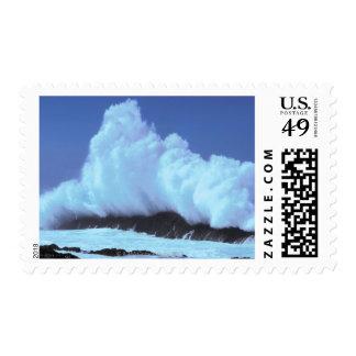 waves crashing against rocks stamp