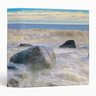 Waves crashing on shoreline rocks binder