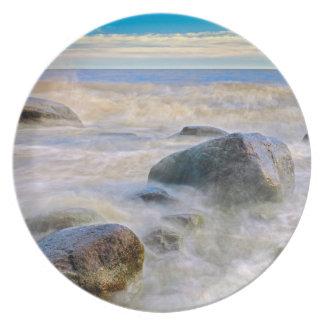 Waves crashing on shoreline rocks melamine plate