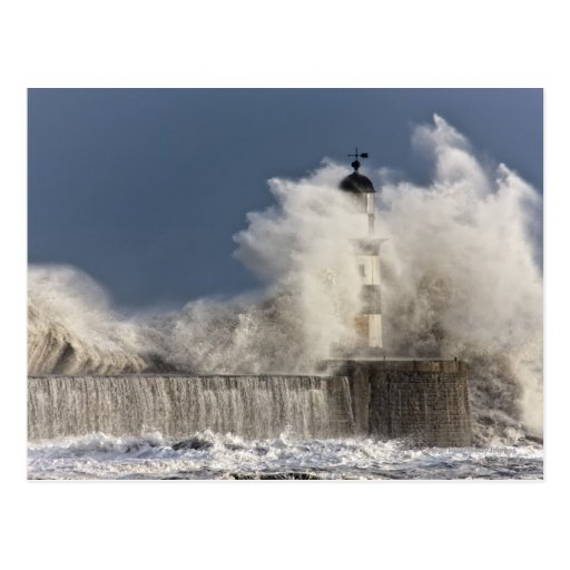 Waves Crashing Up Against A Lighthouse Post Card