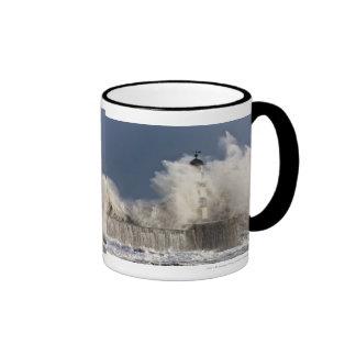 Waves Crashing Up Against A Lighthouse Ringer Mug