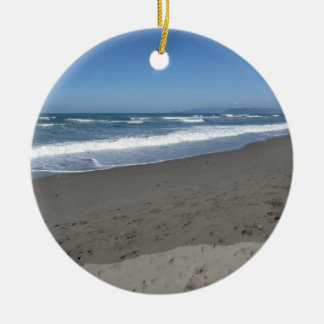 Waves of the sea on the sand beach ceramic ornament