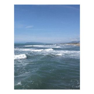 Waves of the sea on the sand beach letterhead