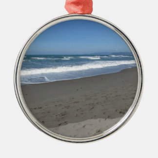 Waves of the sea on the sand beach metal ornament