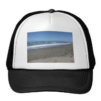 Waves of the sea on the sand beach trucker hat
