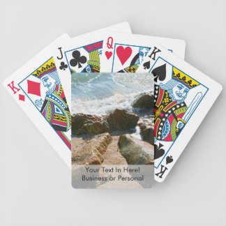 waves on rocks on beach shore image bicycle playing cards