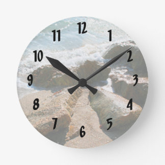 waves on rocks on beach shore image round clock