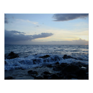 Waves rolling over lava rocks poster