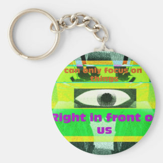 We can only focus on the things right in front basic round button keychain