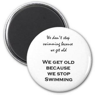 We don't stop swimming because we get old... fridge magnet