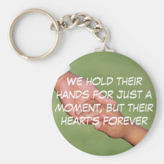 We hold their hands for just a  moment, but their basic round button keychain