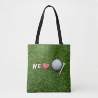 We love golf with golf ball and tee on green grass tote bag
