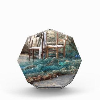 Weathered fishing nets on a harbor pier acrylic award