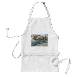 Weathered fishing nets on a harbor pier adult apron