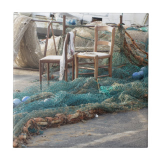 Weathered fishing nets on a harbor pier ceramic tile