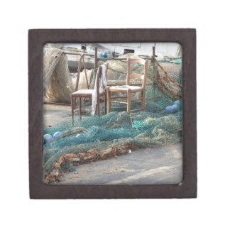 Weathered fishing nets on a harbor pier gift box
